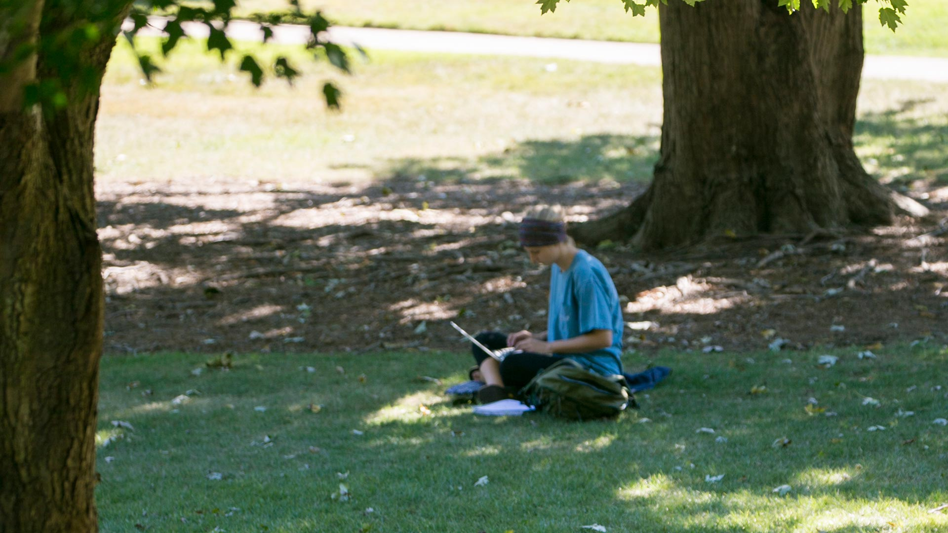 student on quad with laptop