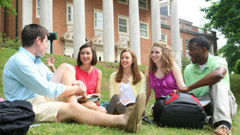 A group of students sitting on the quad.