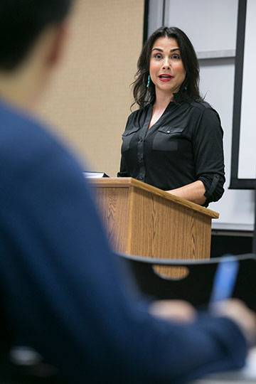 Rachel Baribeau speaking in classroom