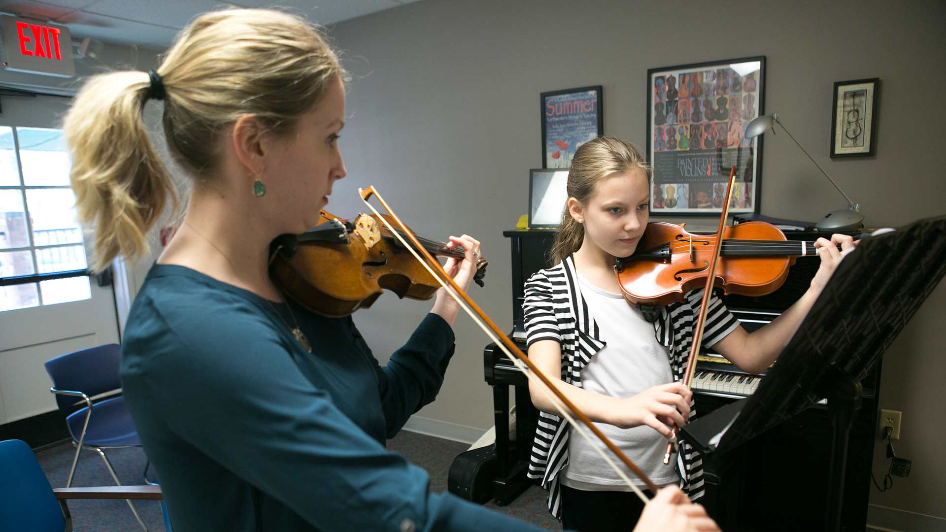 instructor teaching violin