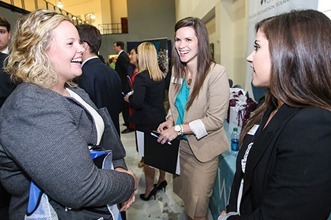 student speaking with employers