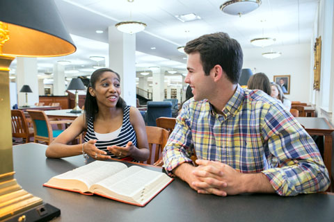 Female and male students in library