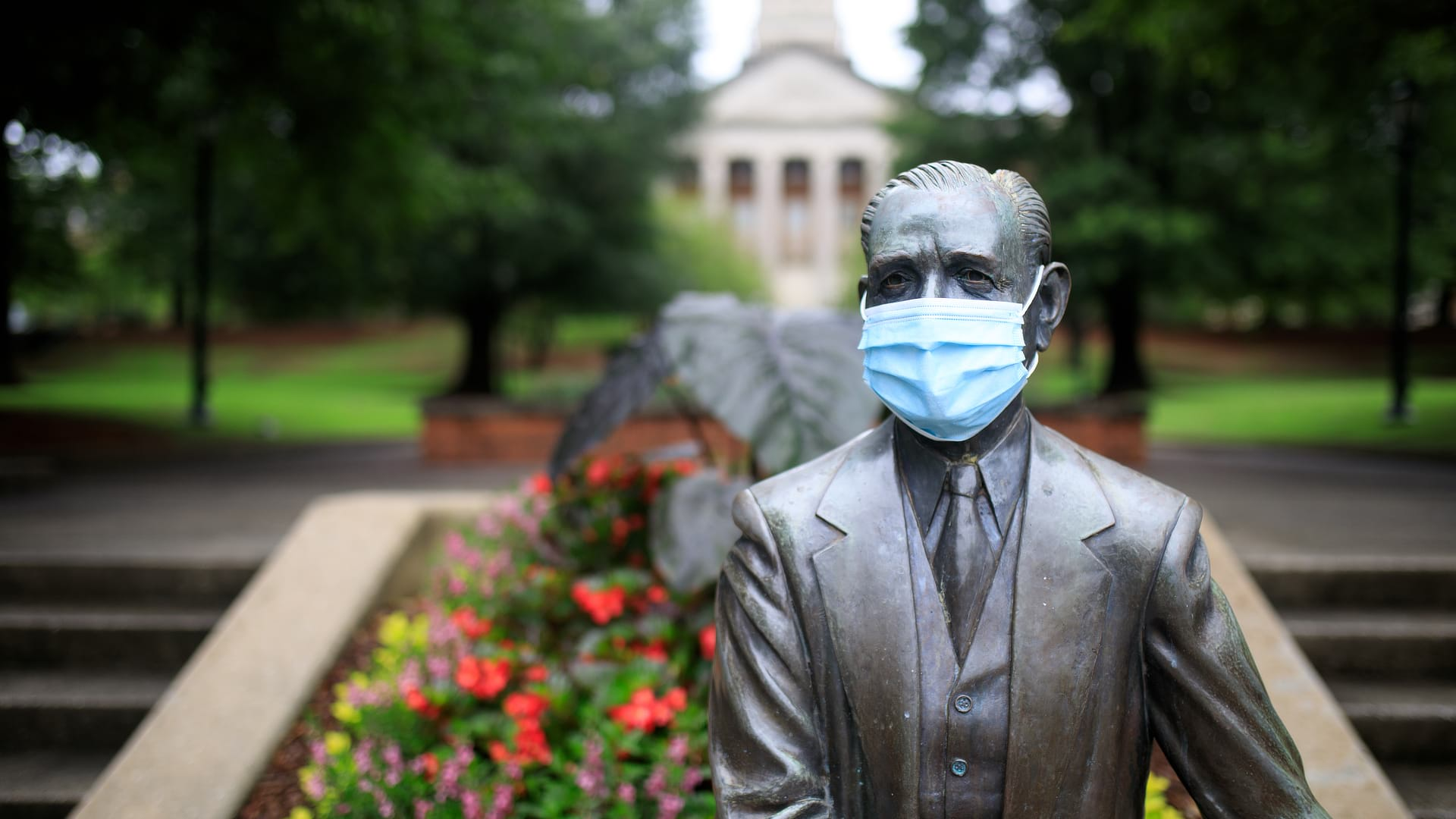 Mr. Beeson Statue wearing a mask
