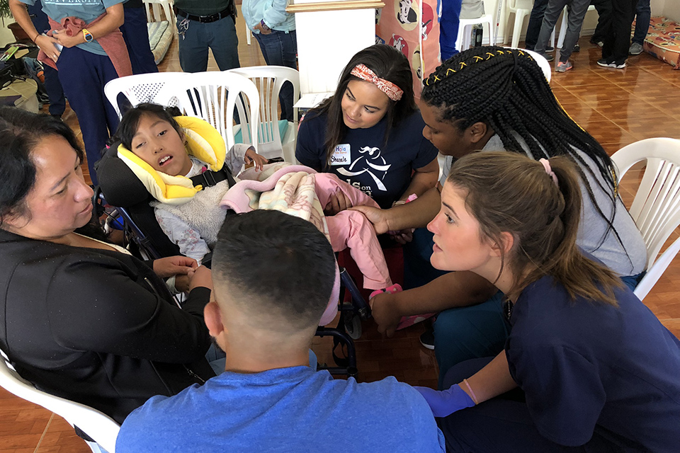 Students working with patients in Ecuador