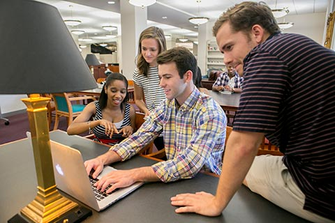 students group studying in library