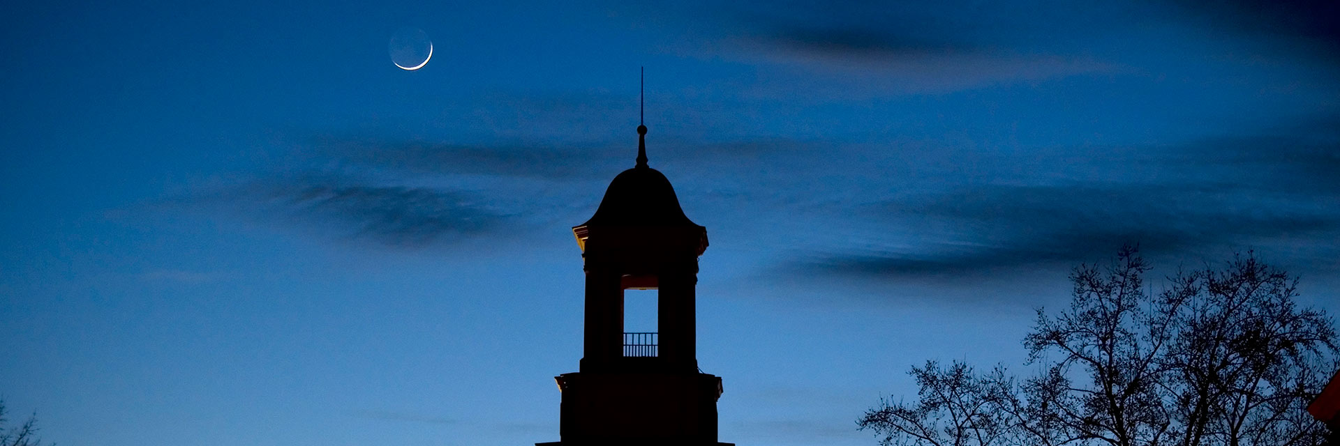 cupola at dusk with sliver moon header