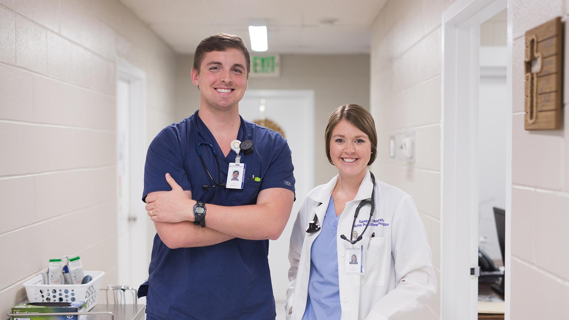 male and female nursing students in hallway