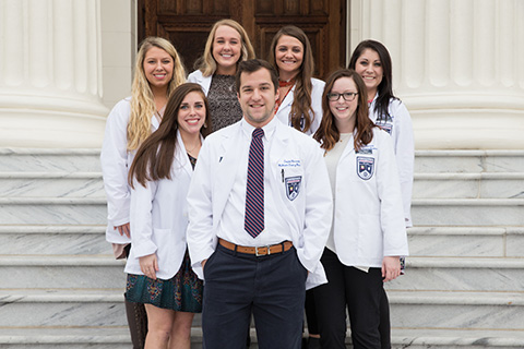 pharmacy students in coats
